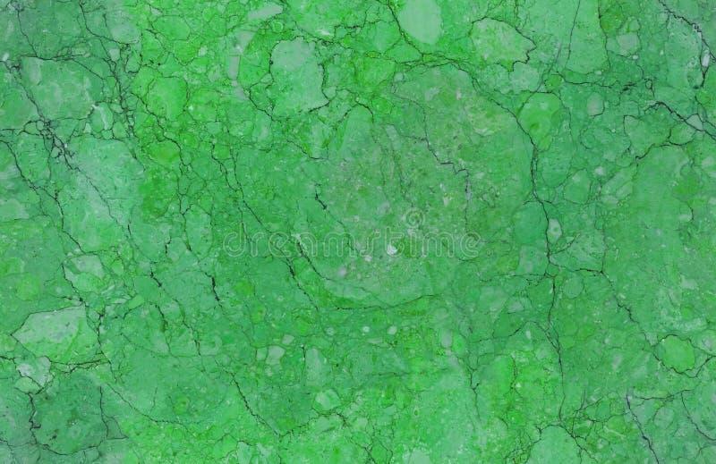 De smaragdgroene natuurlijke naadloze achtergrond van het de textuurpatroon van de graniet marmeren steen Ruwe natuursteen naadlo royalty-vrije stock afbeelding