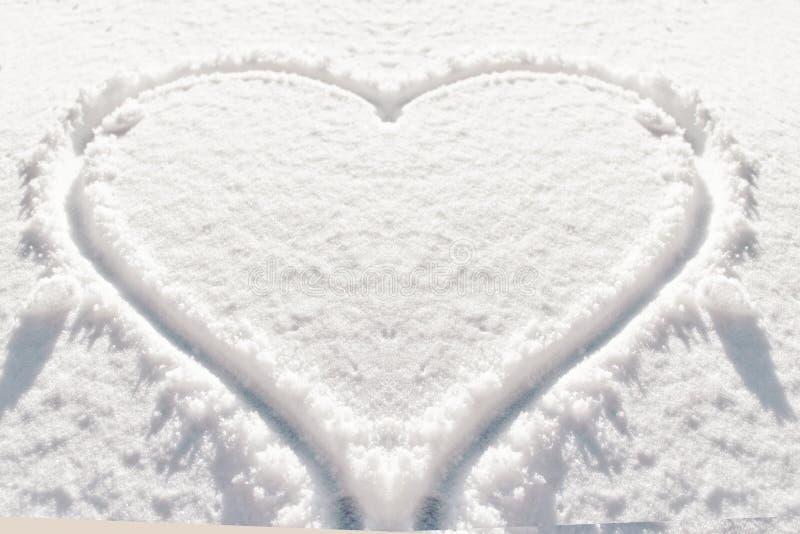 De sneeuwachtergrond van de hartvorm royalty-vrije stock afbeeldingen