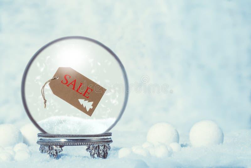 De Sneeuwbol van de de winterverkoop stock foto's