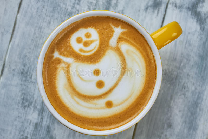 De sneeuwman van de Lattekunst stock afbeelding
