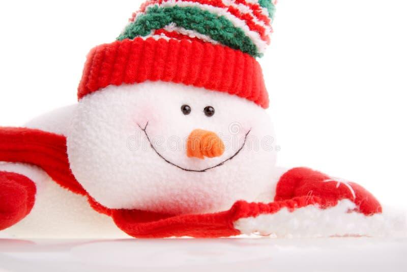 De sneeuwman van Kerstmis die op een witte achtergrond wordt geïsoleerda stock foto's