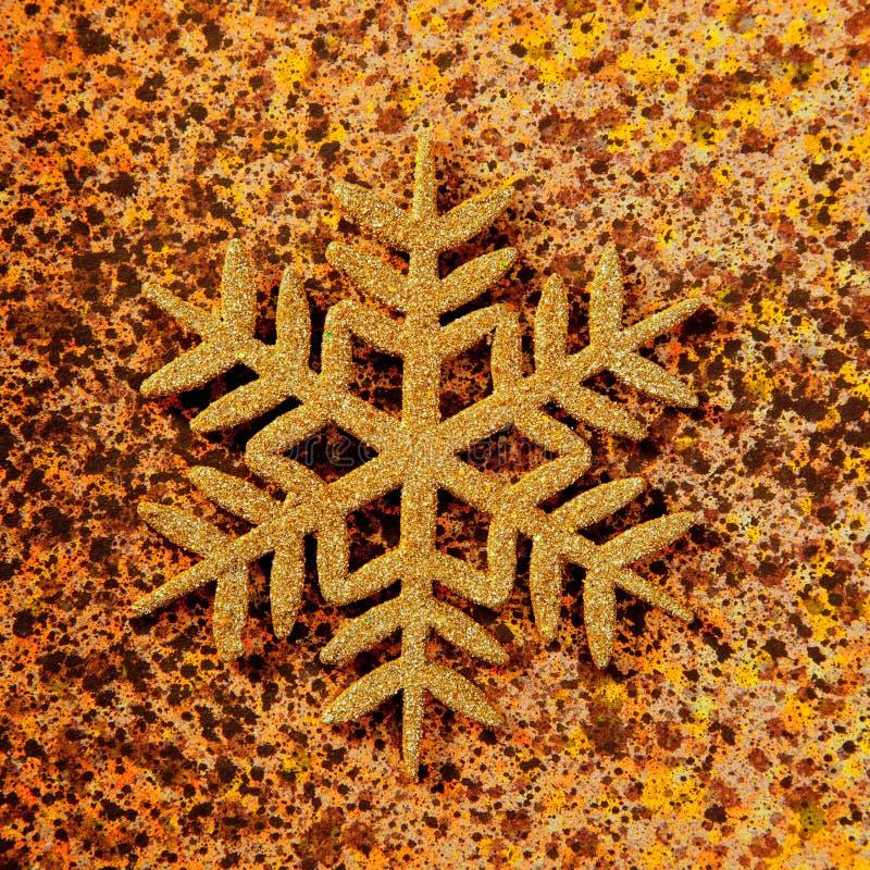 De sneeuwvlok gouden symbool van Kerstmis stock foto