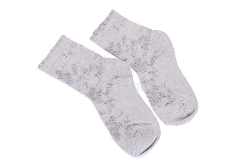De sokken van kinderen op witte achtergrond worden geïsoleerd die stock afbeeldingen