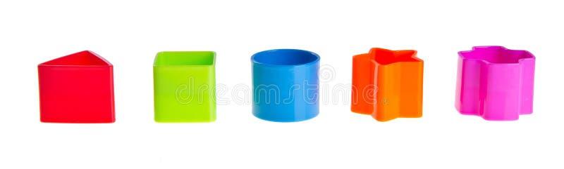 De Sorteerder van de vorm. Stapels Blokken van het Stuk speelgoed op achtergrond stock foto's