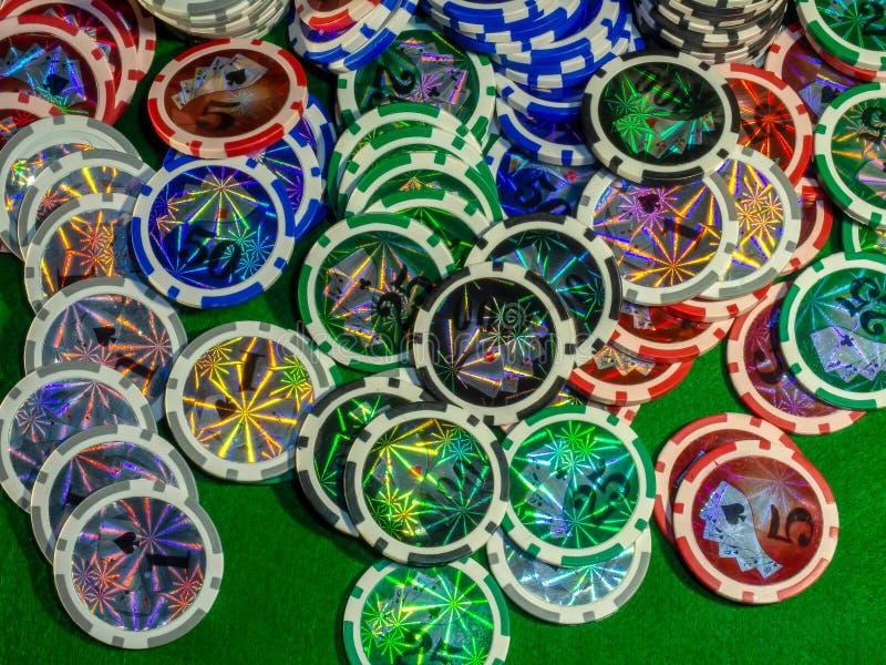 De spaanders en dobbelen voor het spelen van lijst het gokken het blackjack van de pookroulette en de rest stock afbeelding