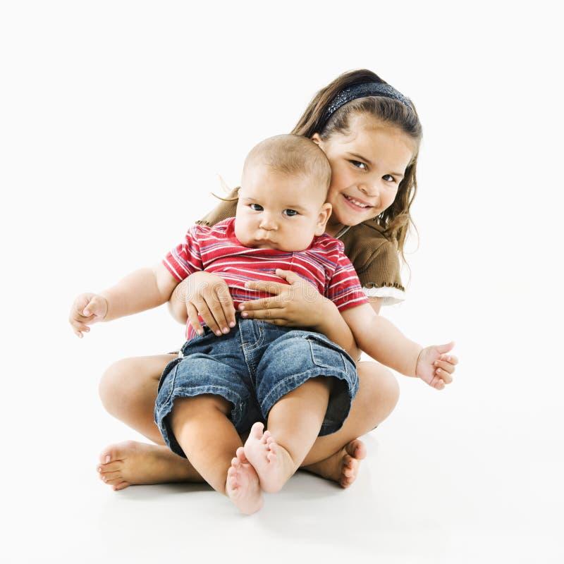 De Spaanse baby van de kindholding. stock foto