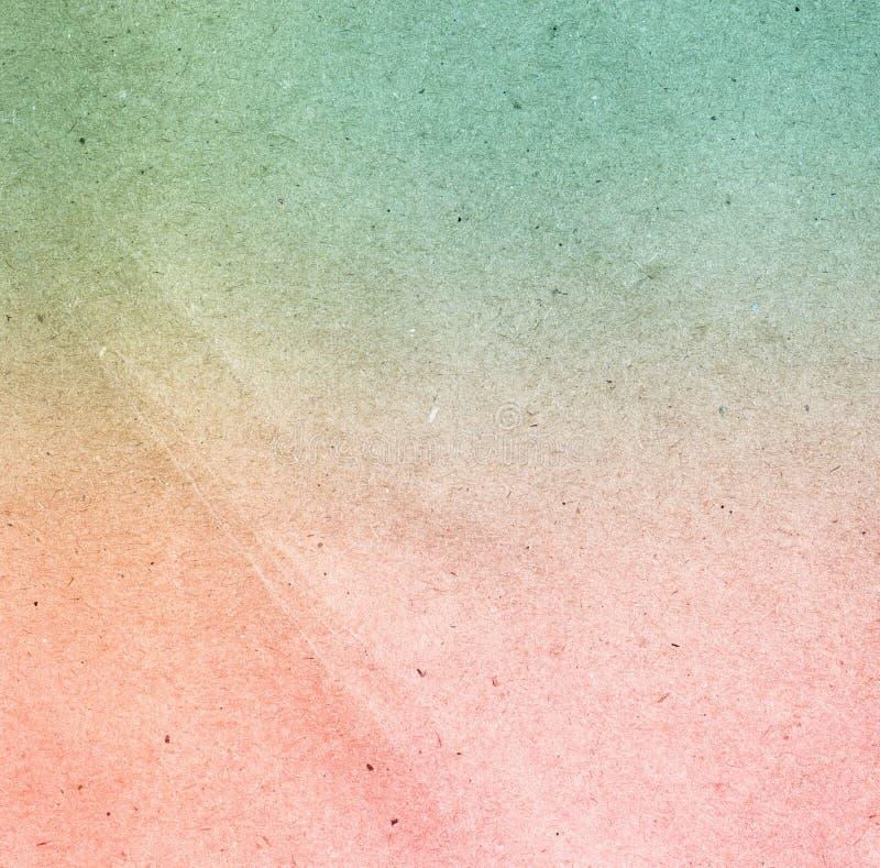 De spatie recycleerde groene en roze sjofele document textuur als achtergrond stock foto