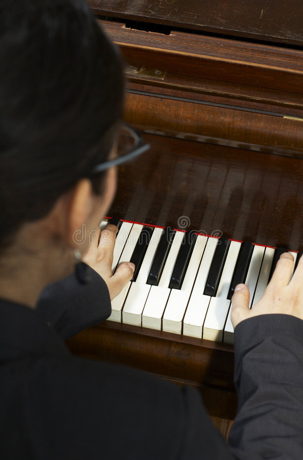 De speel Leraar van de Piano stock afbeelding