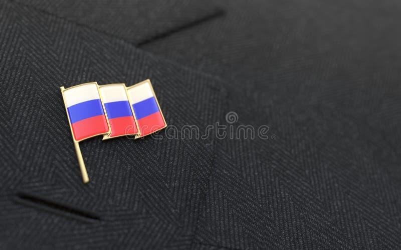 De speld van de de vlagrevers van Rusland op de kraag van een kostuum royalty-vrije stock afbeeldingen