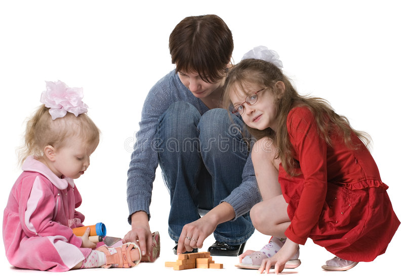 De spelen van de moeder met twee dochters stock foto's