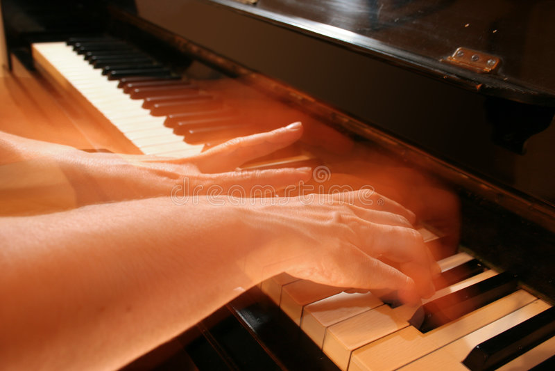 De speler van de piano stock afbeeldingen