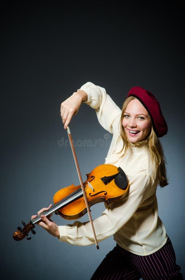 De speler van de vrouwenviool in muzikaal concept royalty-vrije stock foto