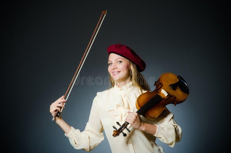 De speler van de vrouwenviool in muzikaal concept royalty-vrije stock fotografie