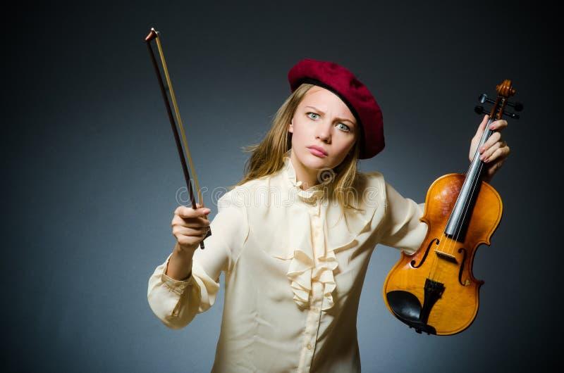 De speler van de vrouwenviool in muzikaal concept royalty-vrije stock afbeeldingen