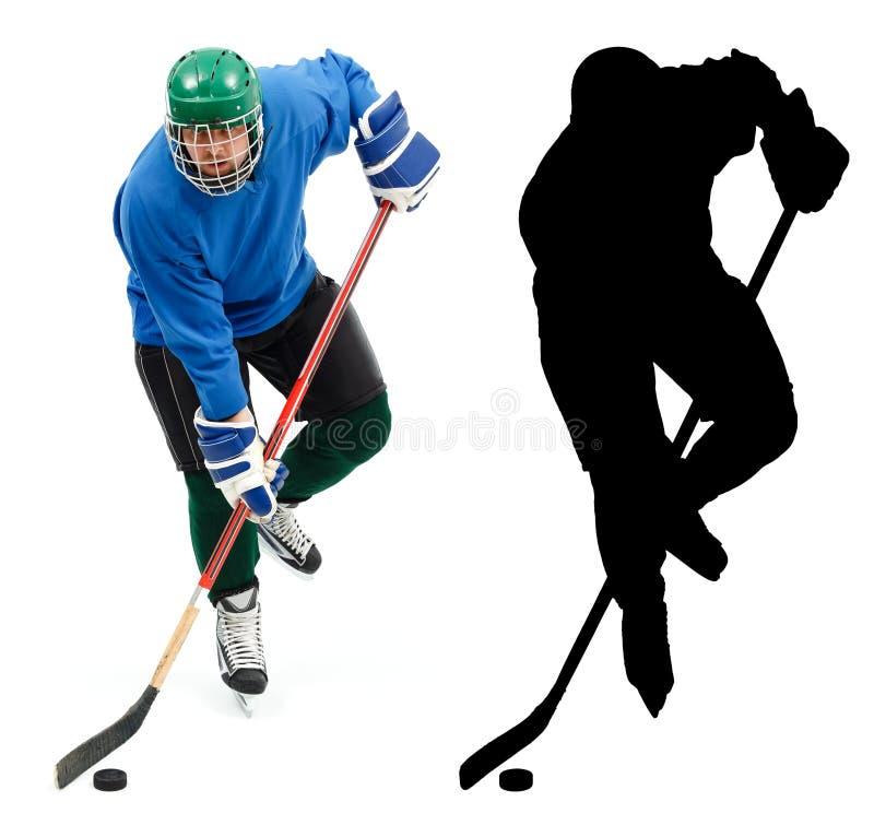 De speler van het ijshockey en het is silhouet stock foto