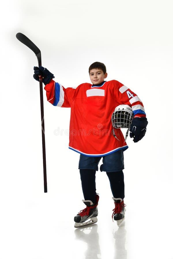 De speler van het jongenshockey in studiosilhouet op witte achtergrond wordt geïsoleerd die stock foto's