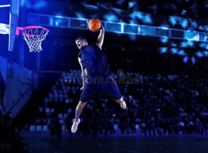 De speler van het mensenbasketbal stock afbeeldingen
