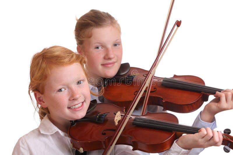 De spelers van de viool stock afbeeldingen