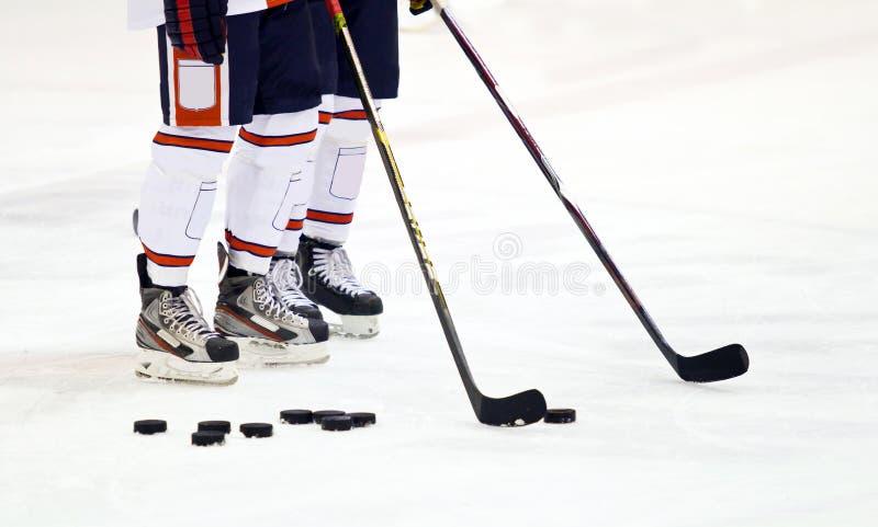 De spelers van het ijshockey stock foto's