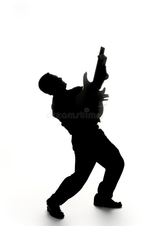 De spelersilhouet van de gitaar stock afbeelding