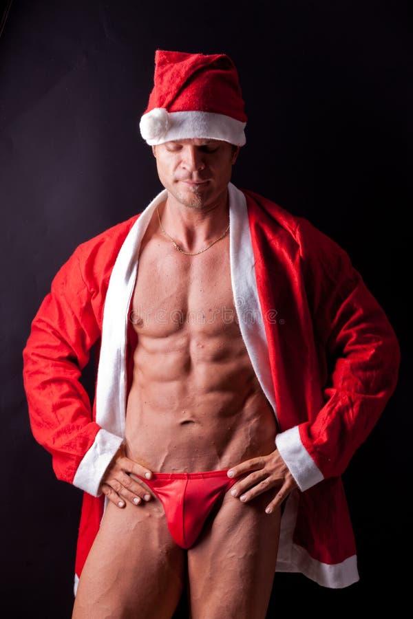 De spier Kerstman stock foto's