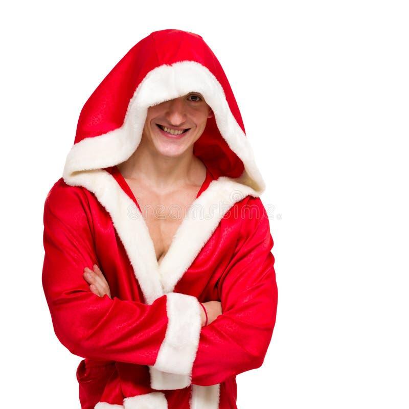 De spier mens die de Kerstman draagt kleedt zich stock afbeeldingen