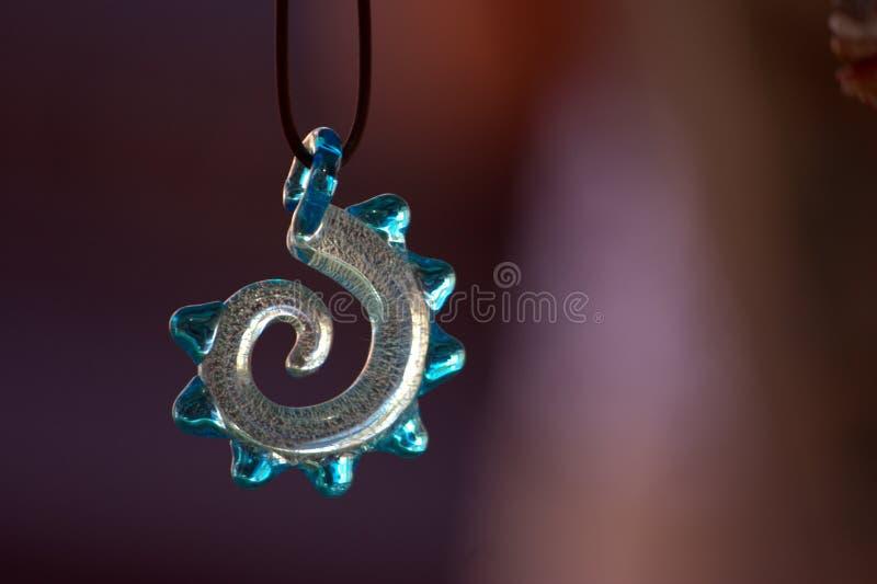 De spiraalvormige tegenhanger van het glas stock afbeeldingen