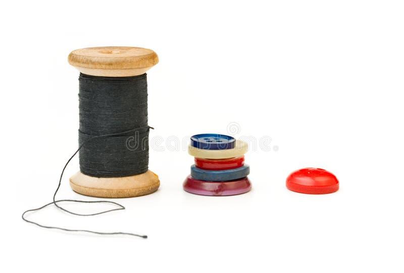 De spoel en de knopen van de draad stock fotografie