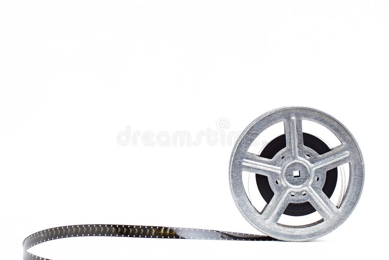 De spoel van de filmfilm op witte achtergrond stock foto