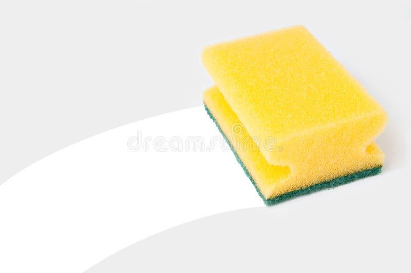 De spons van het huishouden veegt af royalty-vrije stock afbeelding