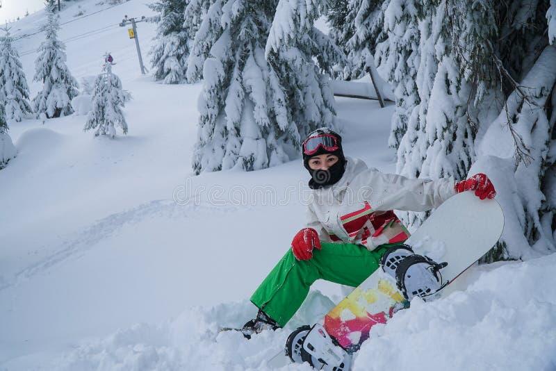 De de sportenwinter van de vrouwen snowboard sneeuw royalty-vrije stock foto