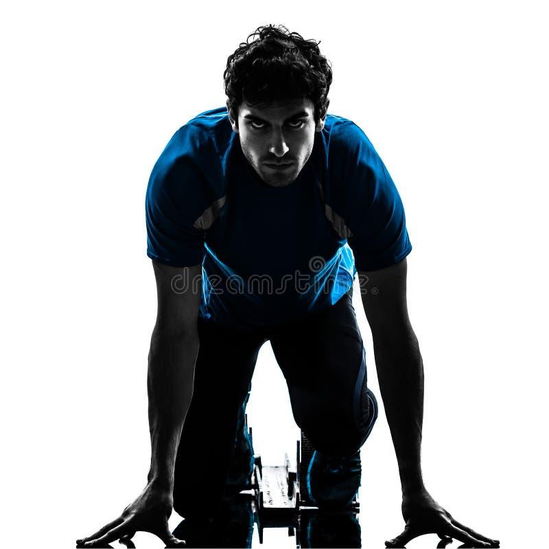 De sprinter van de mensenagent op startblokken   silhouet royalty-vrije stock foto