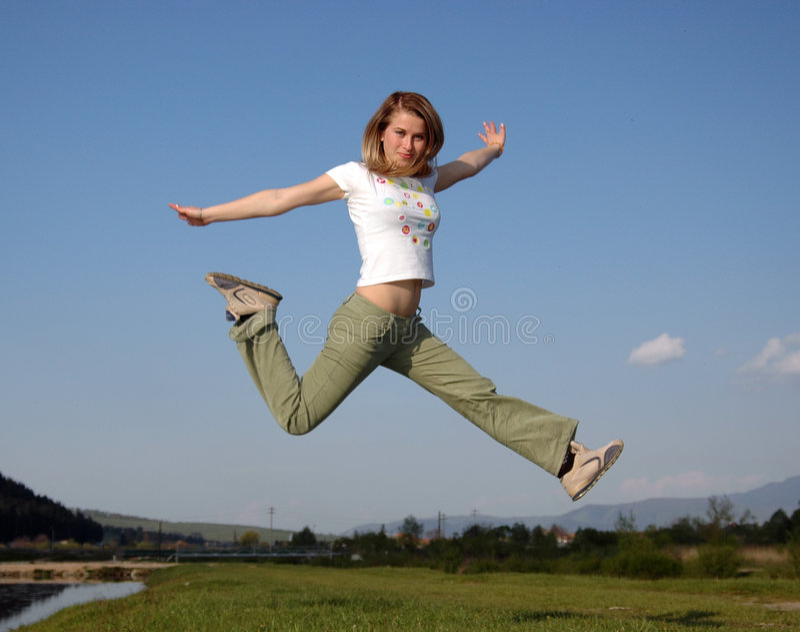 De sprong van de vrouw stock afbeeldingen