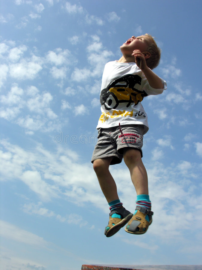 De sprong van het kind stock fotografie