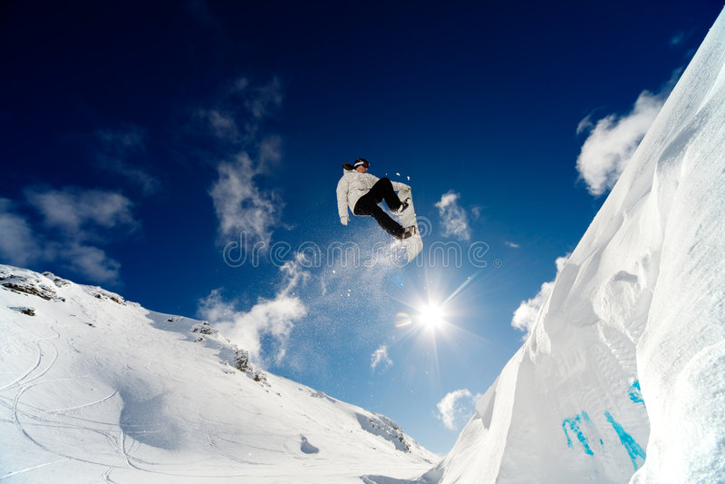 De sprong van Snowboarder stock foto's