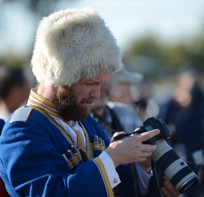 De spruiten van de Kozakfotograaf bij de gebeurtenis stock afbeeldingen
