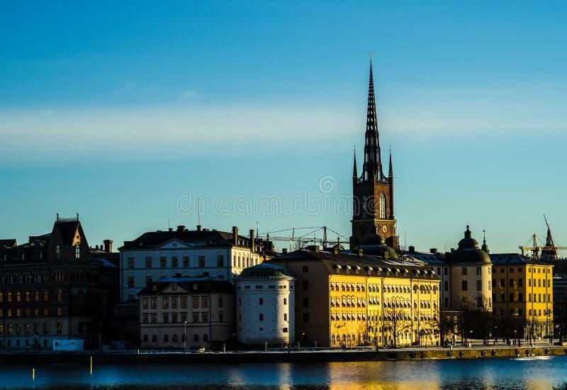 De stad en de zonsopgang van Stockholm stock foto