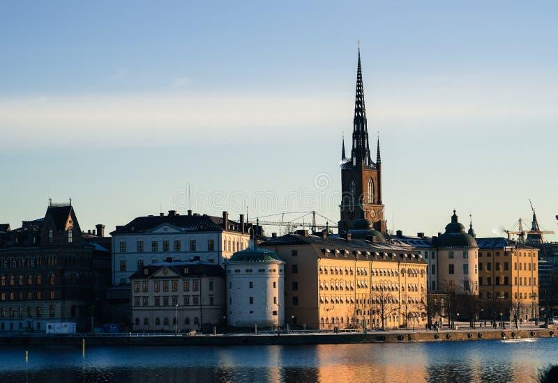 De stad en de zonsopgang van Stockholm stock afbeeldingen