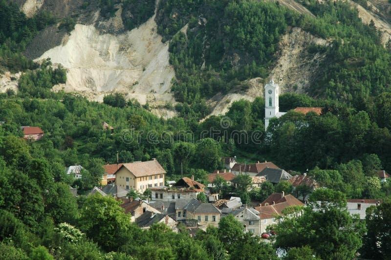 De stad van de mijnbouw, Rosia Montana, Roemenië stock fotografie