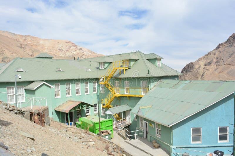 De stad van de spookmijnbouw van Sewell, Chili stock fotografie