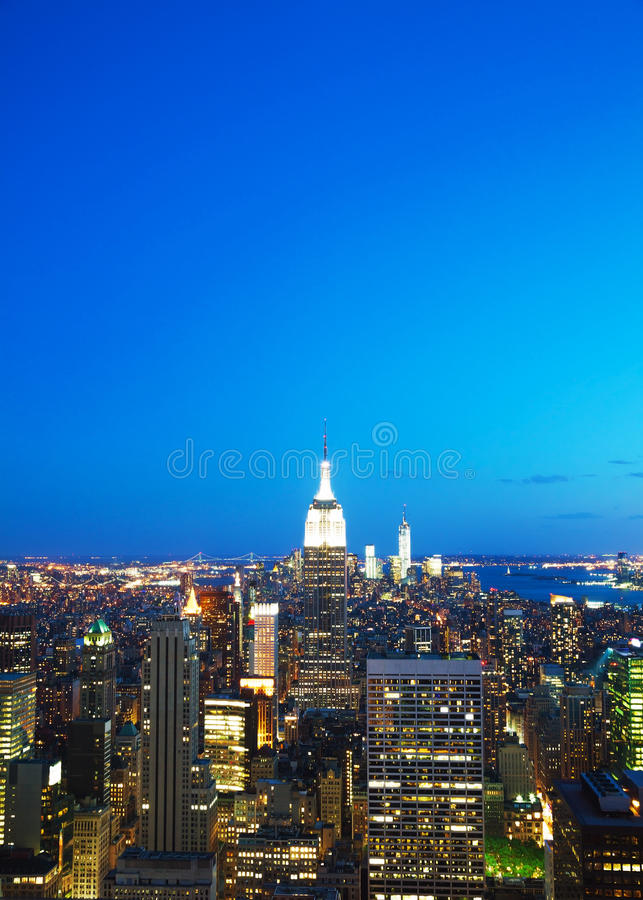 De Stadscityscape van New York in de nacht royalty-vrije stock foto