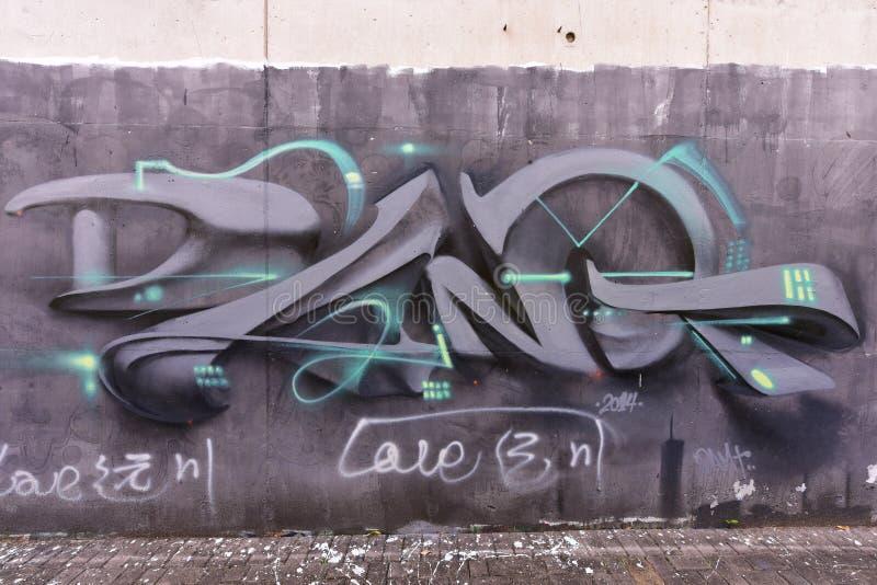 De stadsgraffiti op de cementmuur stock fotografie