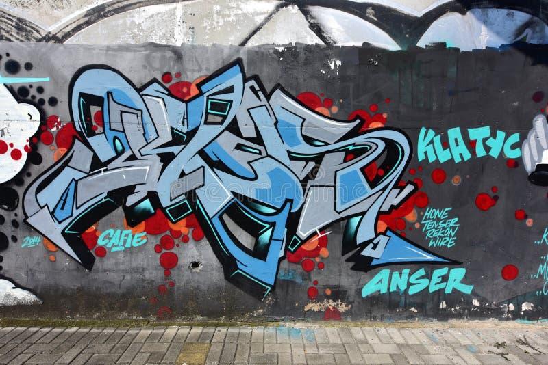 De stadsgraffiti op de cementmuur stock illustratie