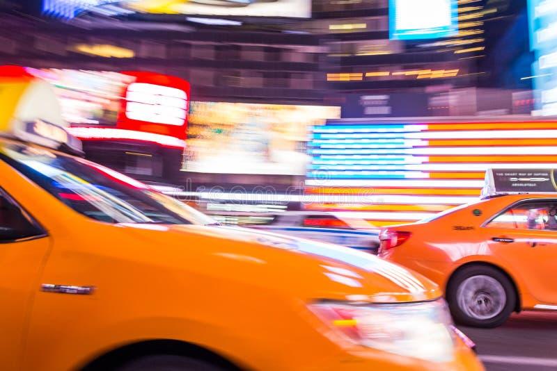 De Stadstaxi van New York, in Motie, Times Square, NYC, de V.S. royalty-vrije stock foto