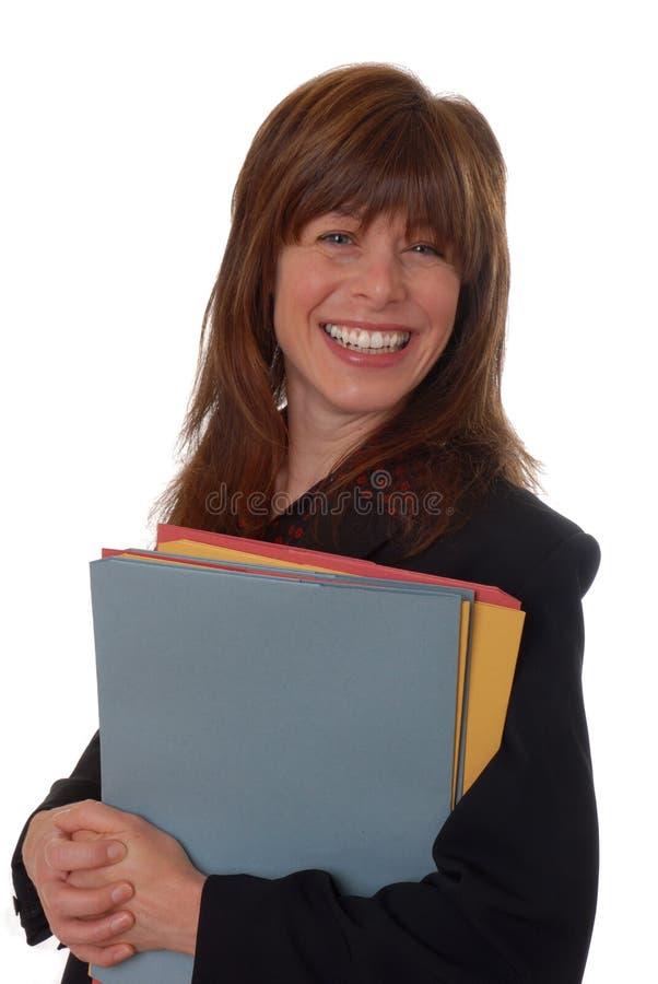 De stafmedewerker van het bureau met dossiers stock afbeeldingen
