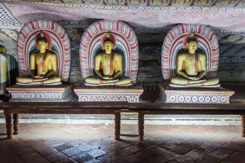 De standbeelden van Boedha in een hol van Dambulla-holtempel, Sri-Lan royalty-vrije stock foto