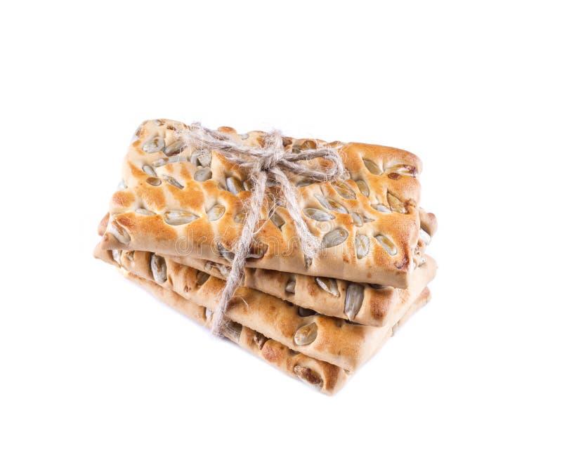 De stapel koekjes met zonnebloemzaden bond met geïsoleerde streng stock foto's