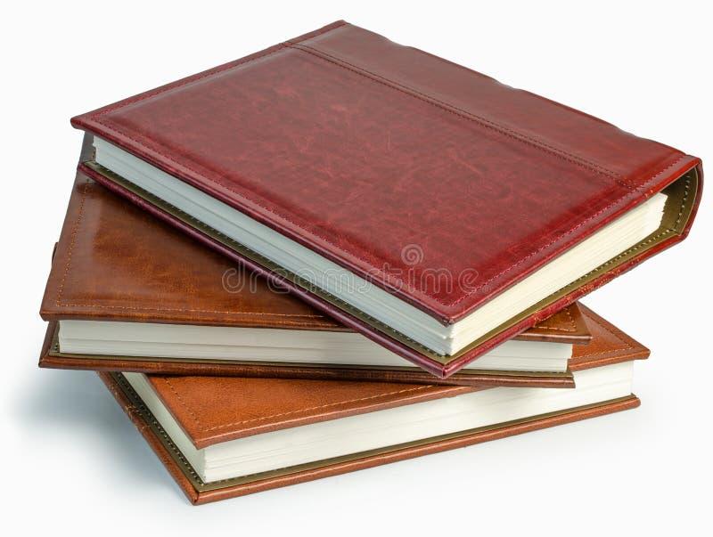 De stapel van drie fotoboeken op witte backround royalty-vrije stock afbeeldingen