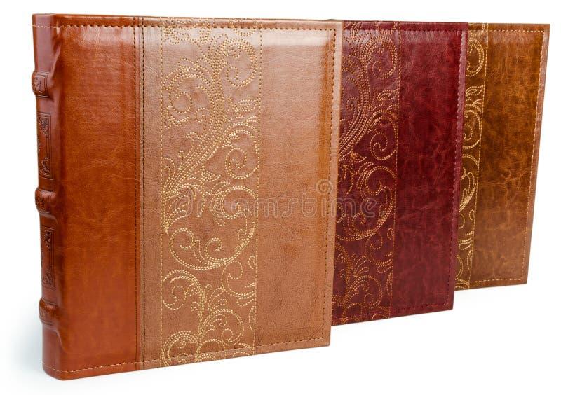 De stapel van drie fotoboeken op witte backround stock fotografie