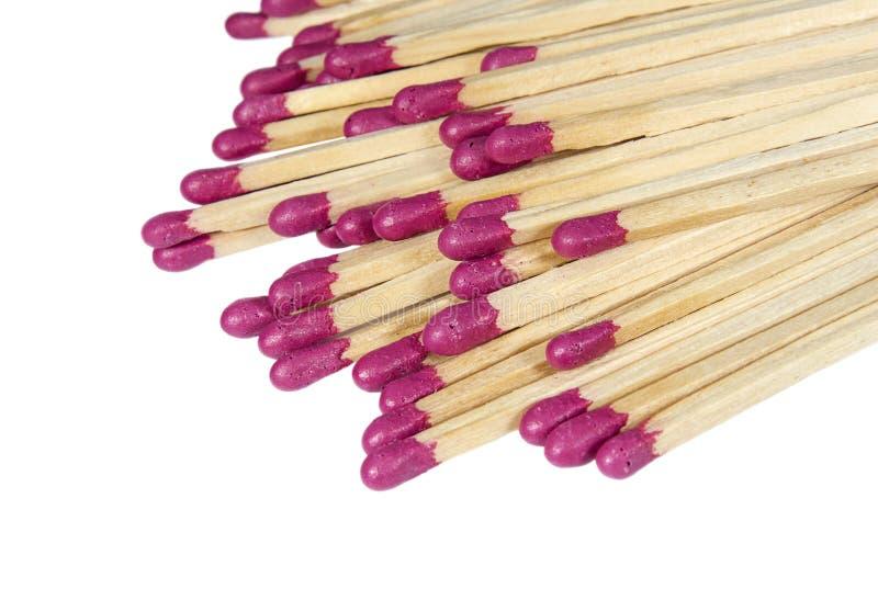 De stapel van houten matchsticks met rode uiteinden sluit omhoog stock afbeeldingen